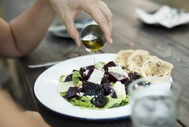 Woman having salad meal at the restaurant